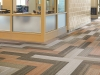 Carpet tile plank installed in herringbone pattern