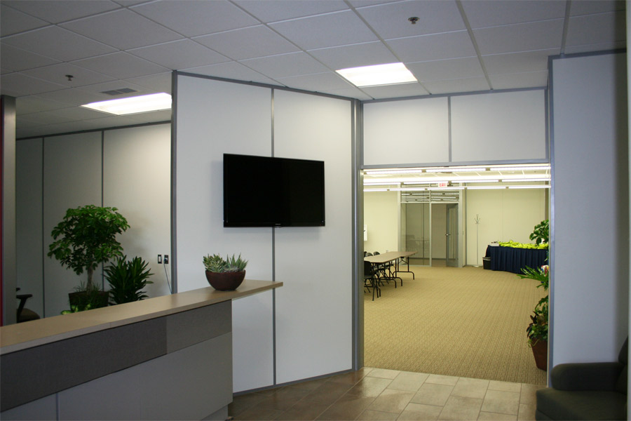 Interior demountable reception wall for entryway