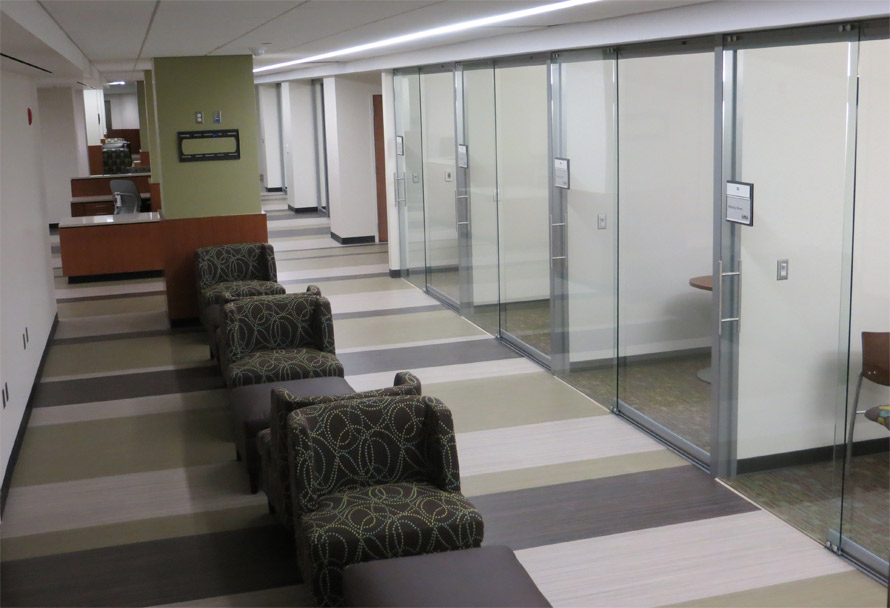 Nxtwall glass walls with sliding frameless glass doors floor to ceiling