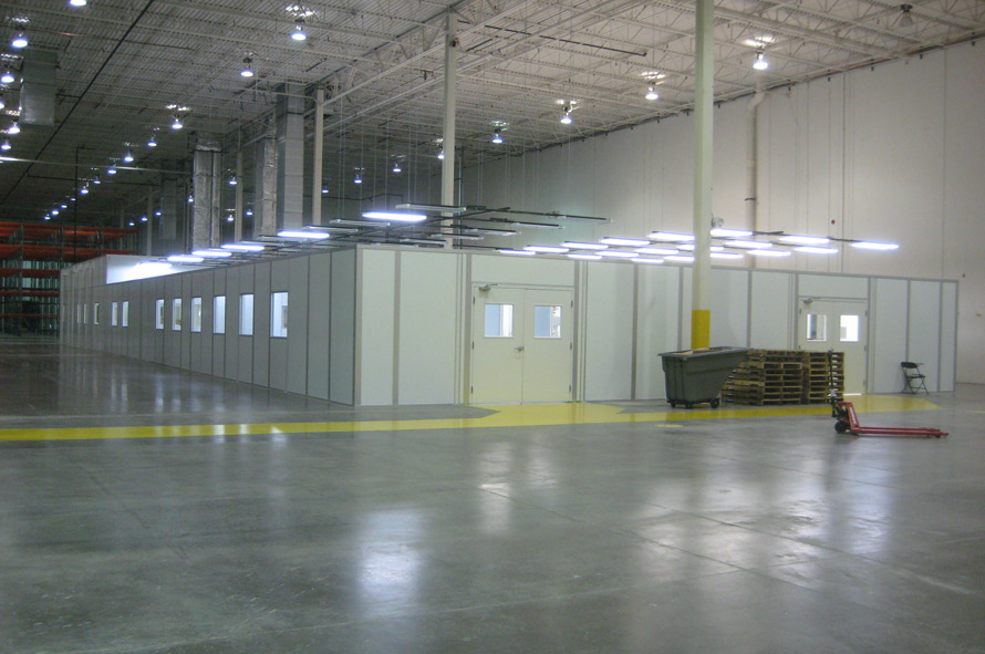 Inplant offices with electrical and solid white vinyl walls