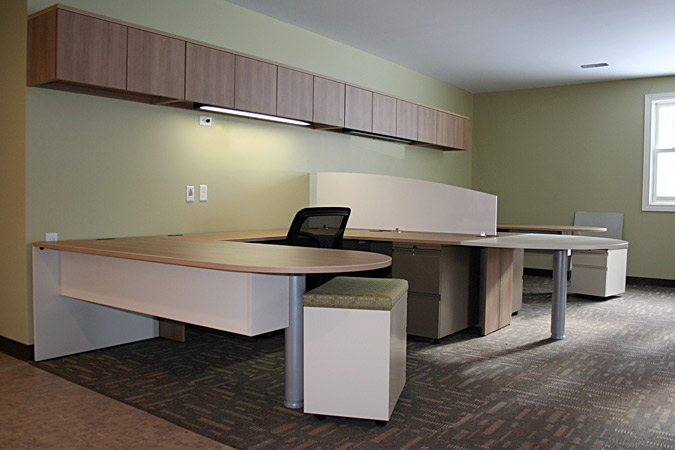 ARTOPEX two person workstation laminate with divider panel and half moon shared worksurface.