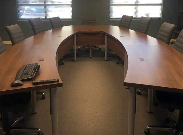U-shape conference table with leather conference chairs